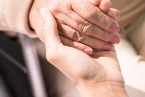 holding-patients-hand-PBHJXMB (1)